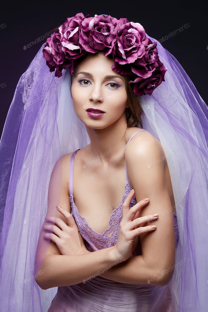 beautiful girl with purple makeup and flowers
