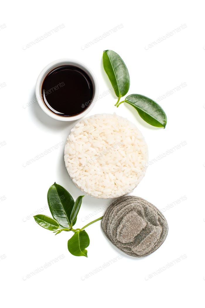 Rice and natural soy sauce on a white background.
