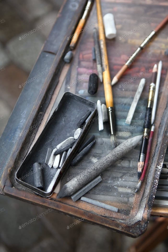 Chalk and charcoal in a painter box