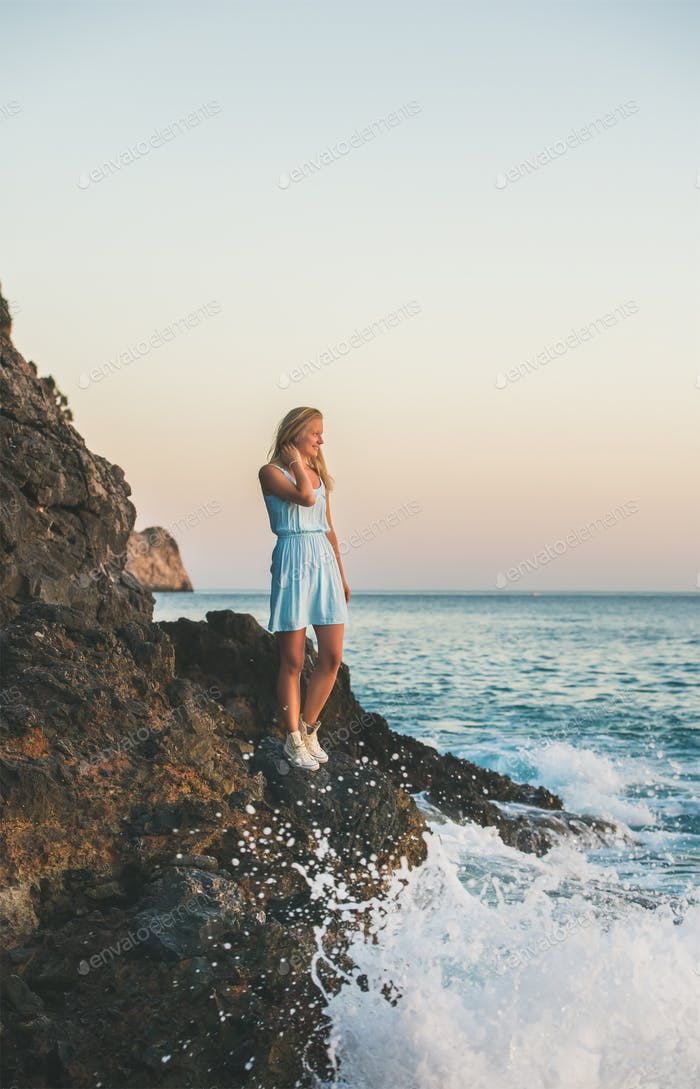 Young blond woman looking at horizon and smiling, Alanya, Turkey