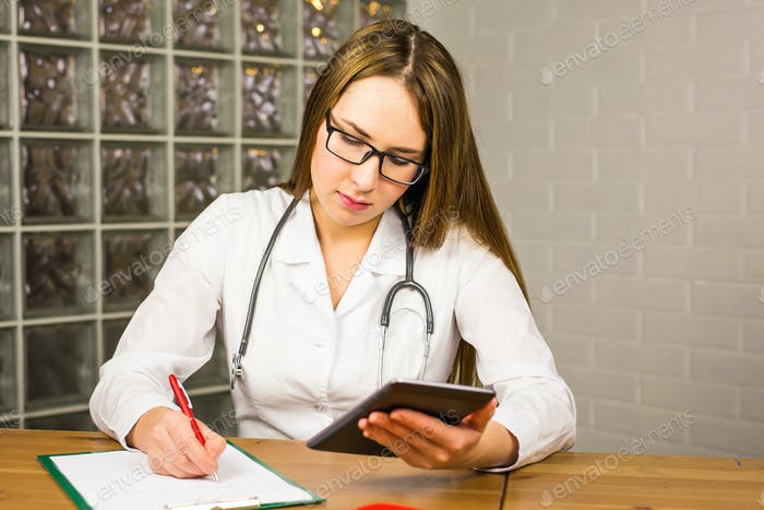 Close-up of doctor using a tablet computer in a hospital
