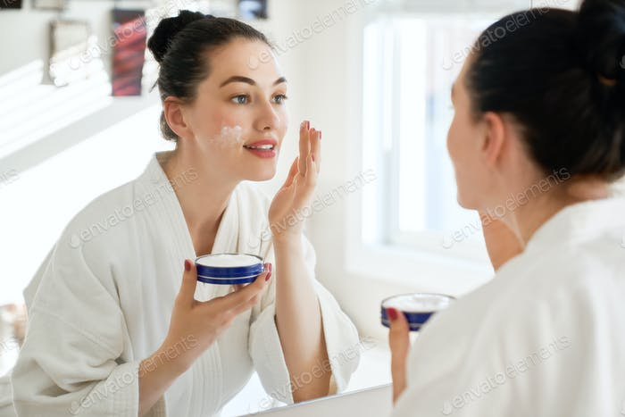 woman with cream for her face