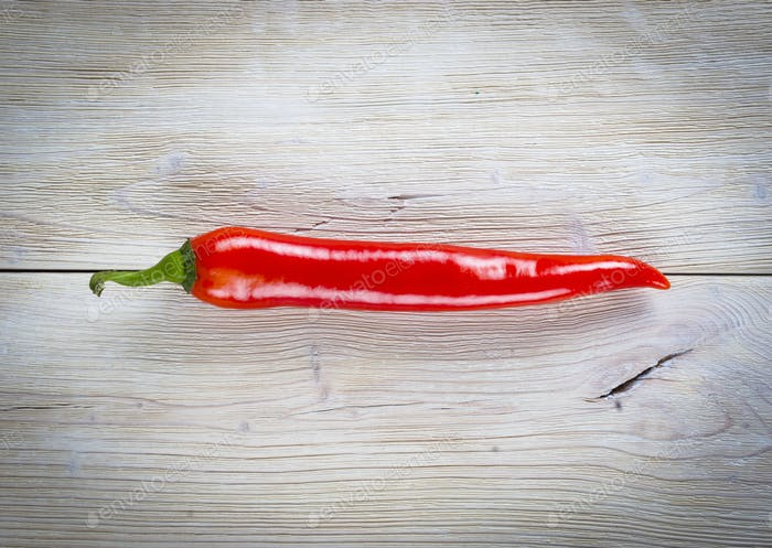 red chili pepper on rustic wooden background
