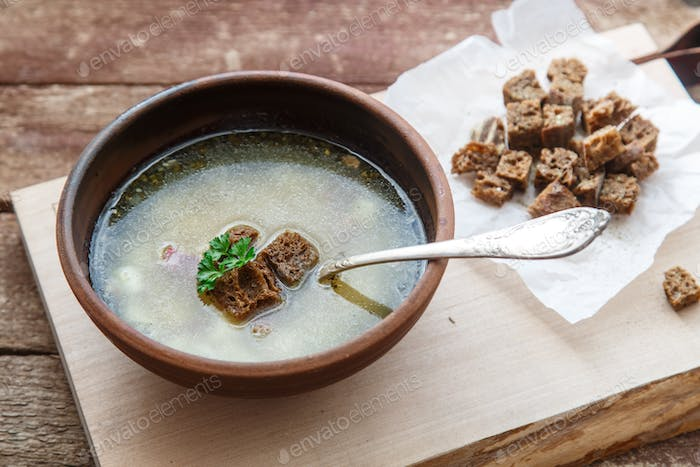 Bowl of a garlic soup with croutons. Traditional Czech and Slovak dish - chesnechka.