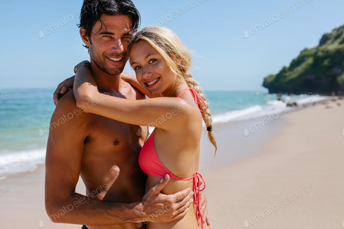 Loving couple on beach holiday