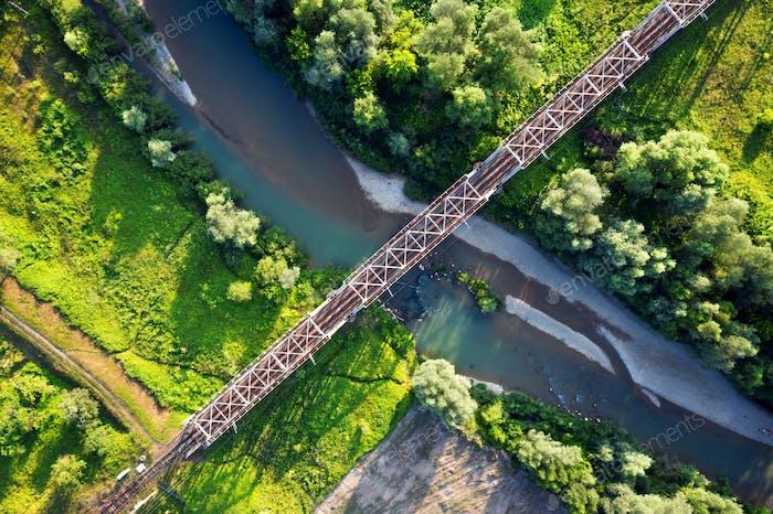 Steel railroad bridge above a small river