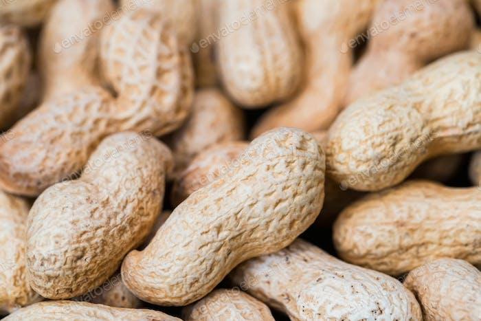 Schließen Sie ungeschälte Erdnüsse für Hintergrundbild
