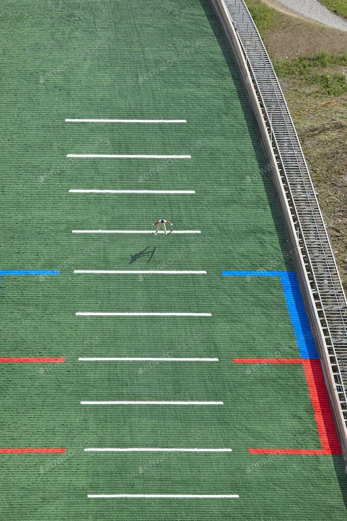 Ski jump. Artificial track. Sport background. Norwegian summer. Vertical