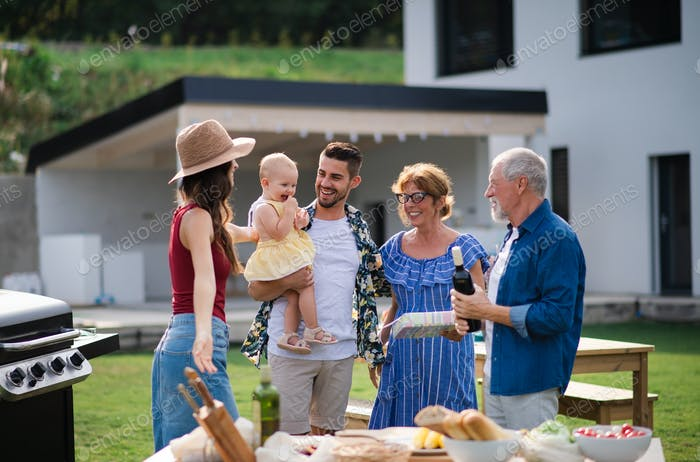 Portrait of happy people outdoors on family birthday party