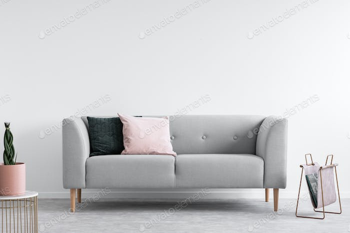 Scandinavian minimal design with grey comfortable sofa, real pho
