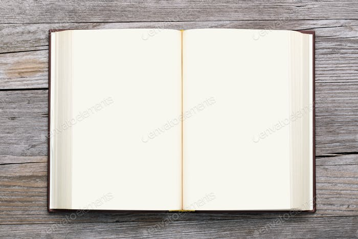 blank book open on old wooden background