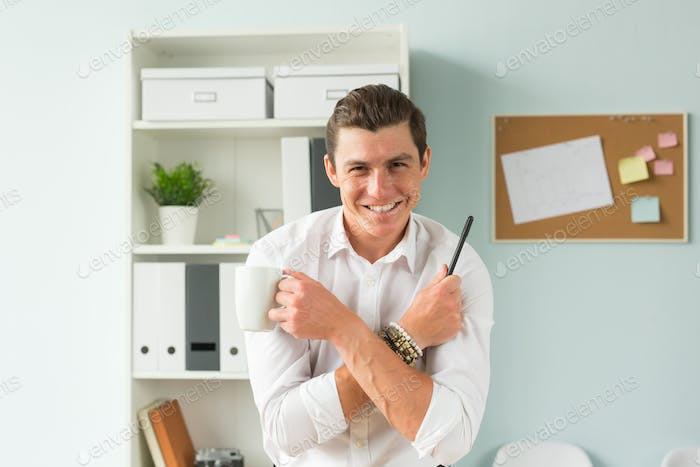Handsome businessman having fun in the office
