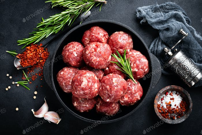 Fresh raw beef meatballs with spices