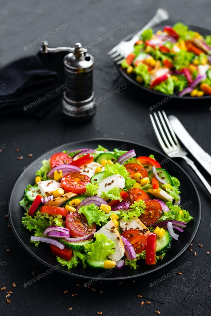 Vegetable salad with chicken meat. Salad with chicken breast and raw vegetables