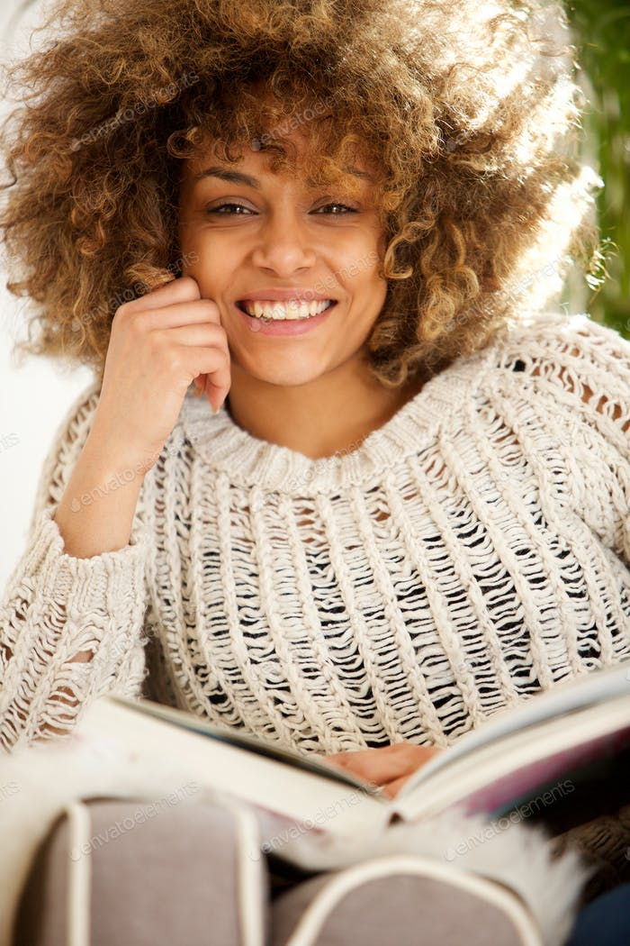 african american female college student sitting and reading