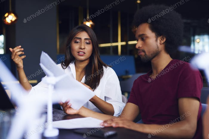 Business couple analyzing the documents at work