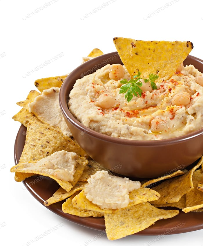 Healthy homemade hummus with olive oil and pita chips