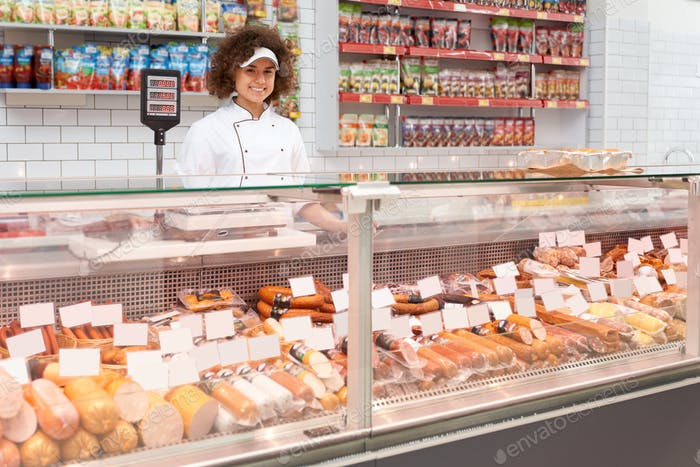 Shop worker posing behind counter