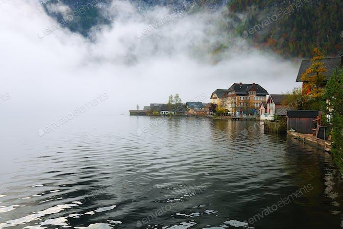 Hallstatt mountain village with Hallstatter lake. Foggy autumn sunrise on Hallstatt lake