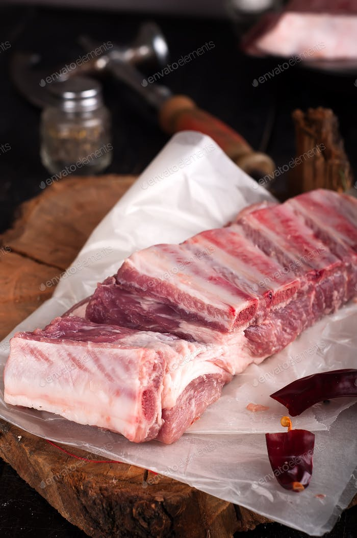 Raw ribs  on a  wooden table