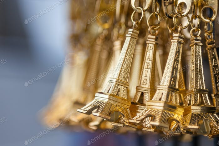 Small gold Eiffel tower key chain in a souvenir shop