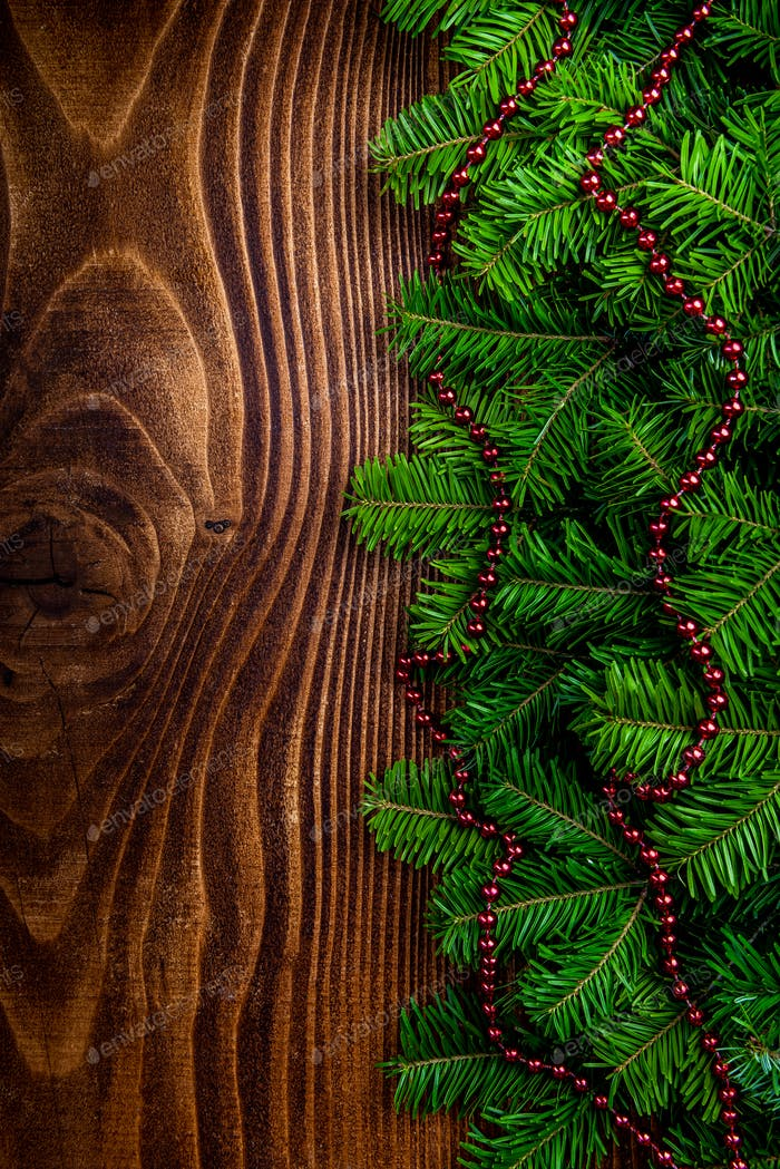 Christmas Border Background . Green Pine Garland on Wooden Board