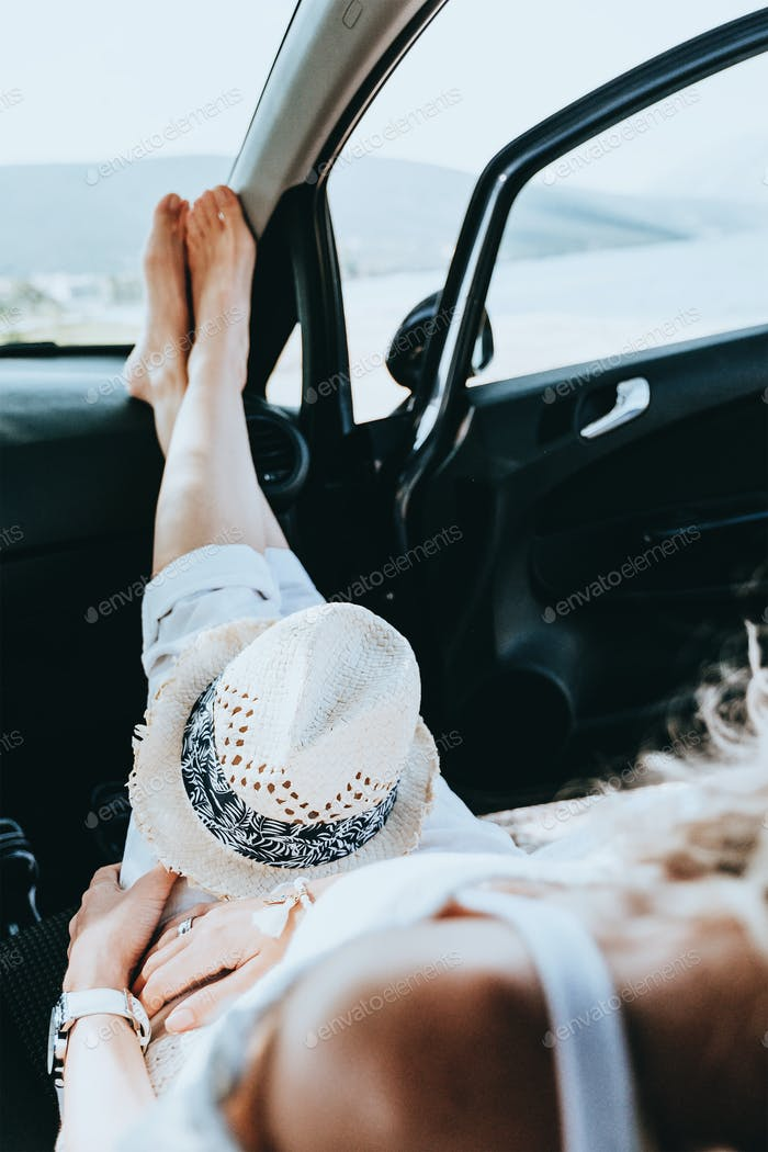 Girl having a rest in a car