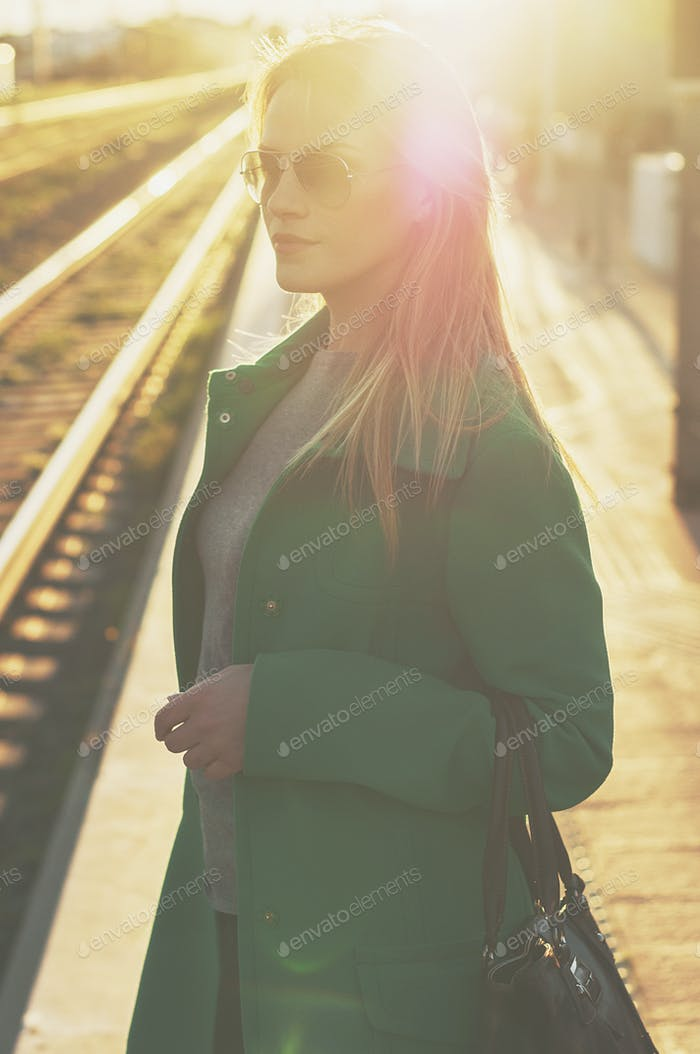 Amazing blond woman waiting for a train