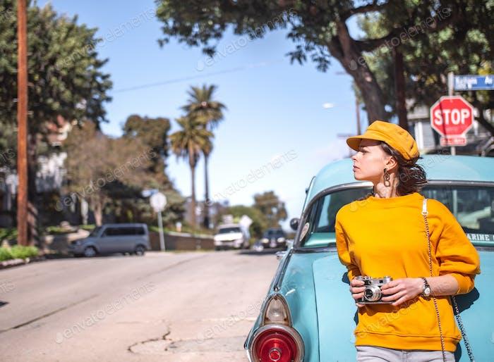 Young girl in a retro car in California