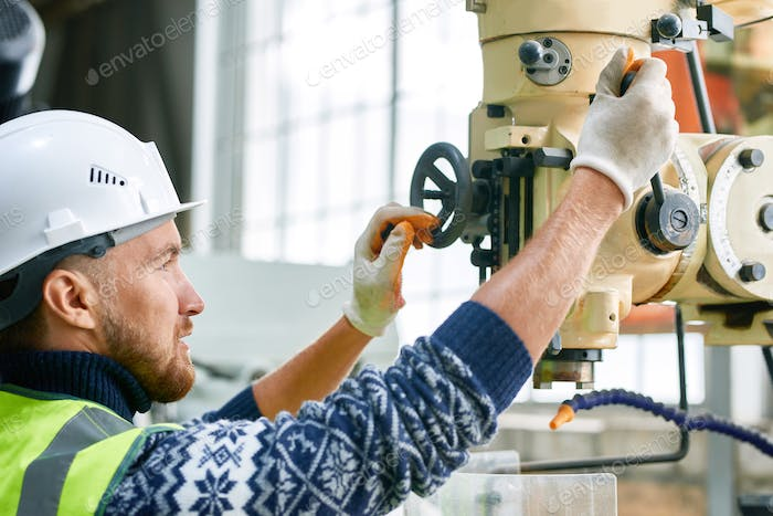 Factory Worker Using Machine Units