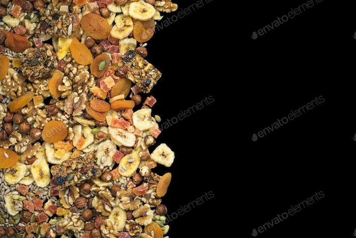 Dried fruits and nuts isolated on black