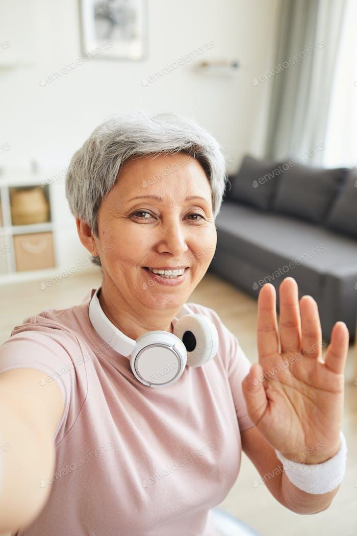 Senior woman say Hello