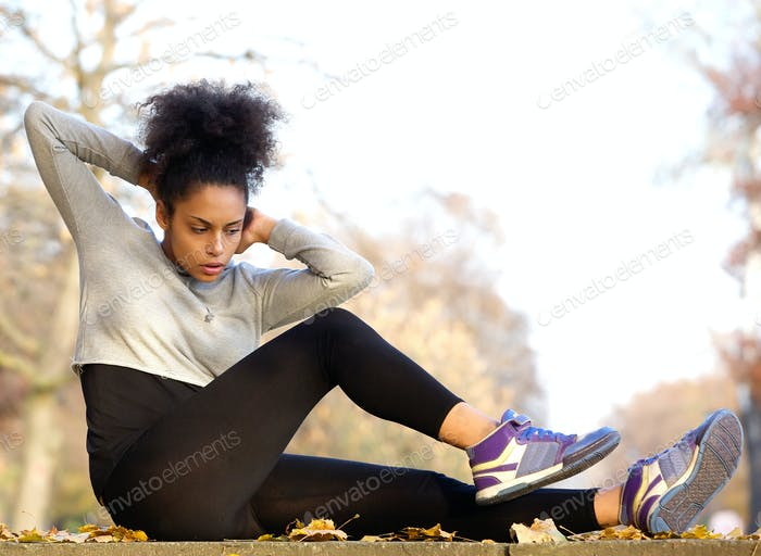 Young african american woman exercising sit ups