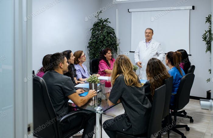 concentrated group of young team workers of dental clinic in a m