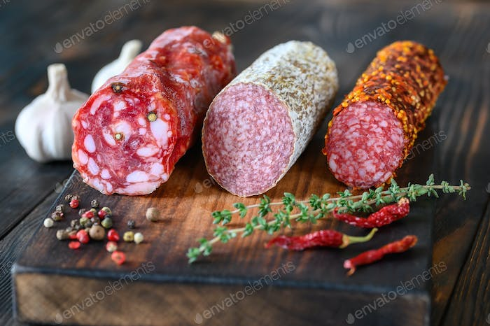 Assortment of salami on the wooden board