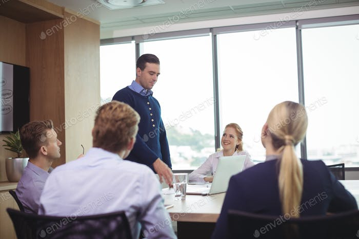 Business people discussing during meeting