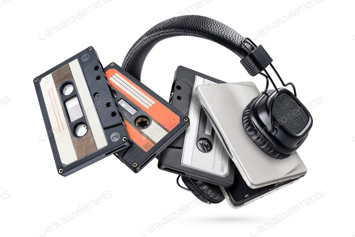 Portable player with headphones and tapes isolated on white