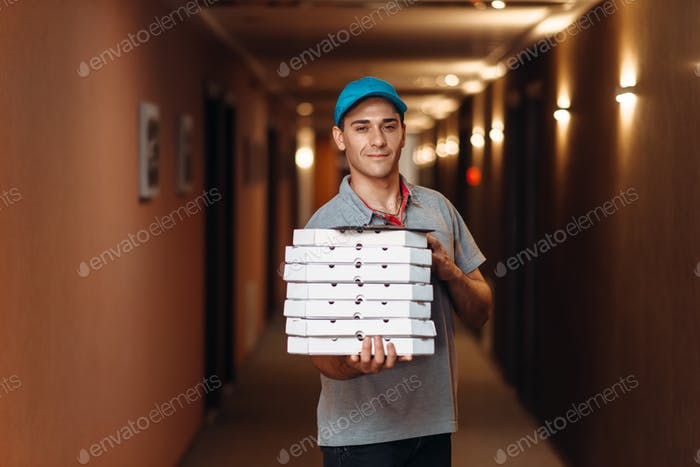 Delivery man with fresh pizza in carton boxes