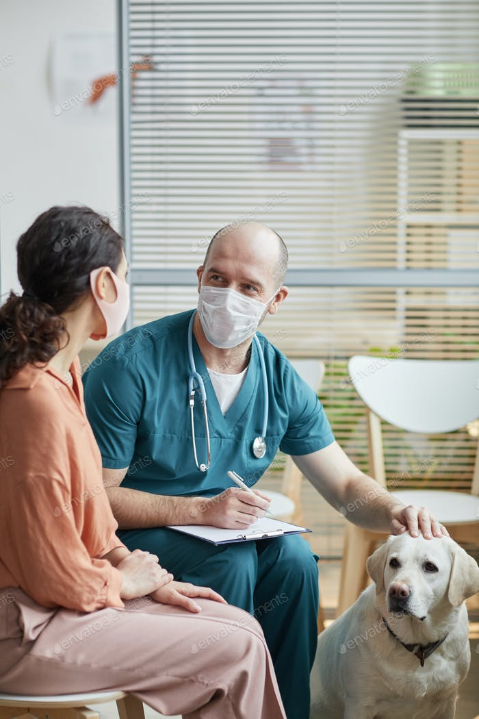 Veterinarian Consulting Woman at Vet Clinic