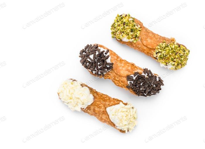 Three cannoli pastries