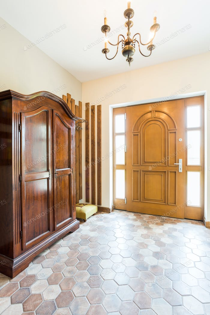 Spacious hallway with wooden wardrobe