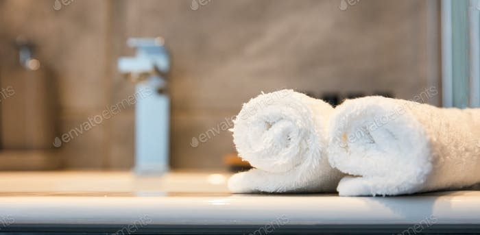 Luxury bathroom sink and white towels. Closeup view with details