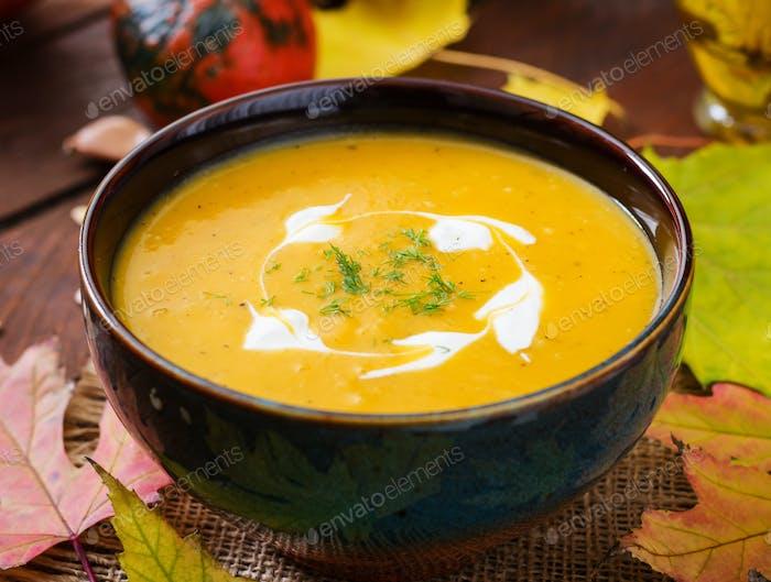 Cream of pumpkin soup with sour cream sauce. Halloween.