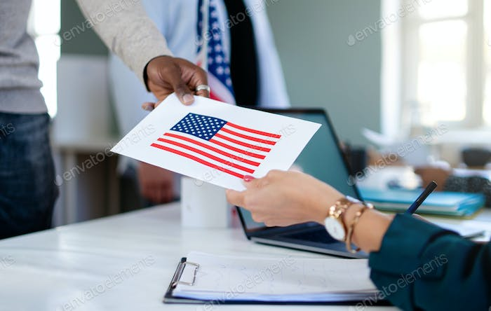 Unrecognizable people with face mask voting in polling place, usa elections and coronavirus