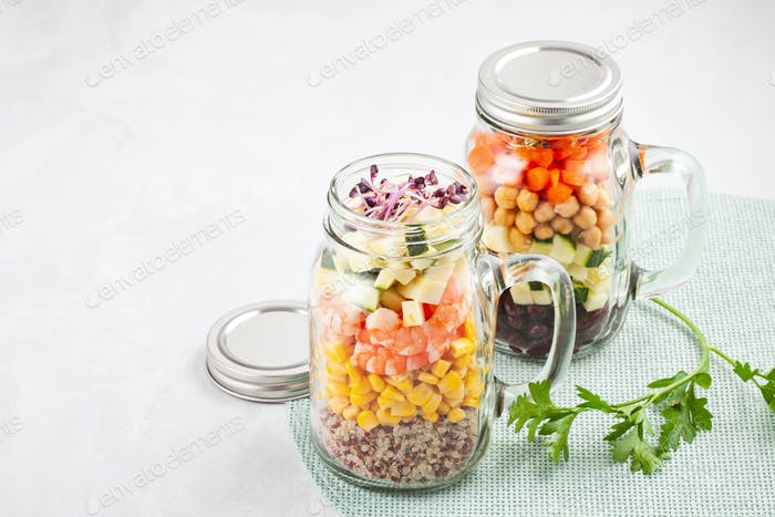 Fresh homemade salad in jars with quinoa, chickpeas and organic
