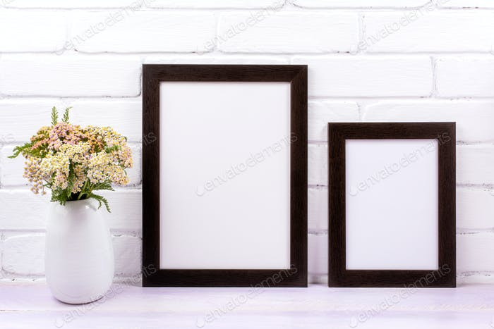 Two black poster frames mockup with pink yarrow