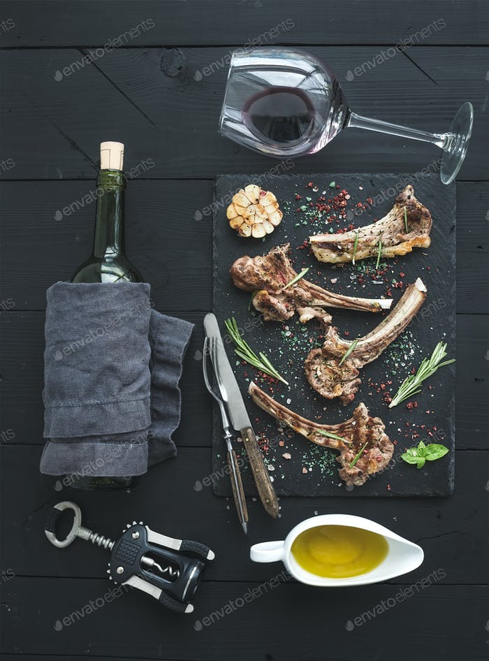 Grilled lamb chops. Rack of Lamb with garlic, rosemary, spices on slate tray