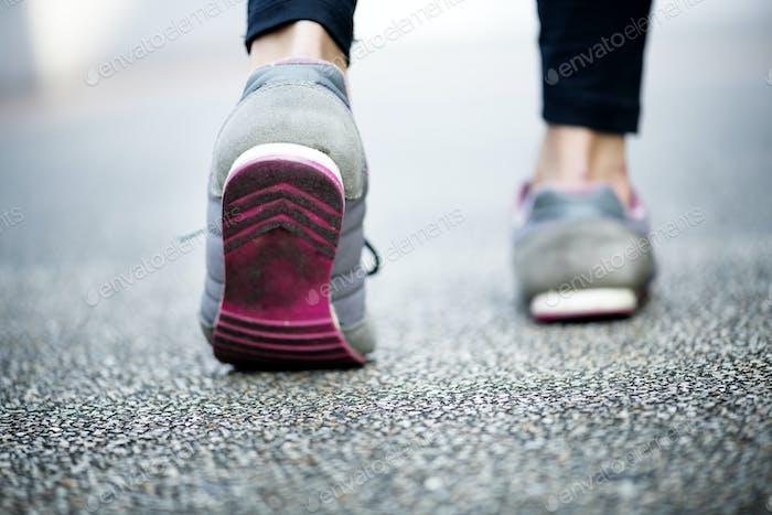 Woman walking on a road