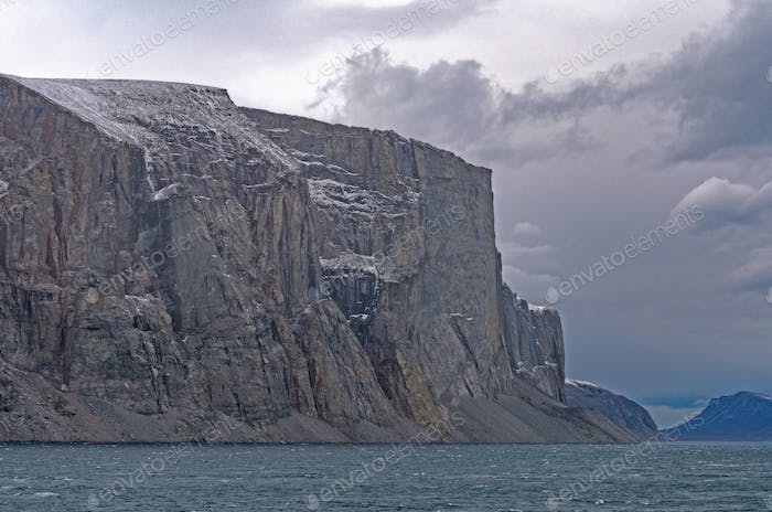 Dramatic Cliffs Guarding the Fjord