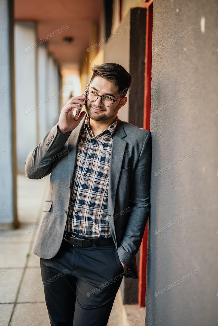 Young man talking on his mobile phone